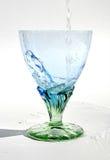Riegue fluir en el vidrio Foto de archivo libre de regalías