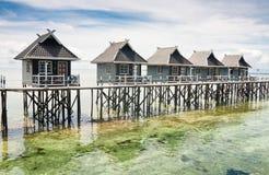 Riegue las casas en la isla de Mabul - Borneo, Sabah, Malasia Imagen de archivo