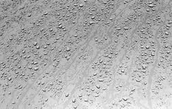 Riegue los descensos en superficie de metal con efecto de la falta de definición Foto de archivo