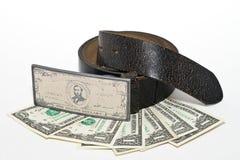 Riem, gesp en sommige dollars stock afbeeldingen