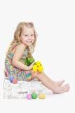 Riendo dos años de la muchacha en Eastertide Imagen de archivo libre de regalías