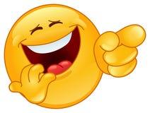 Riendo y señalando el emoticon foto de archivo