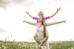 Riends having fun in a daisy field Royalty Free Stock Photo