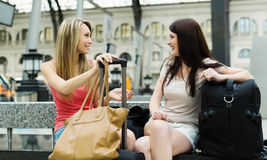 Riends with luggage at railway station Stock Photo