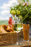 Riesling at wine festival, pretzels and flowers Stock Photo