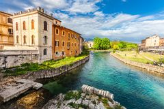 Rieti, city of central Italy. Fiume Velino with ancient houses and Roman bridge at the bottom Stock Photo