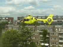 Emergency medical trauma helicopter. Rietland park, Amsterdam, the Netherlands -July 18 2018: emergency medical trauma helicopter lands in Amsterdam to attend stock photos