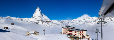 Riffelberg hotel with Matterhorn Peak in background. Zermatt, Switzerland- April 13,2016 : Riffelberg hotel and ski pistes with Matterhorn Peak in background, a stock images
