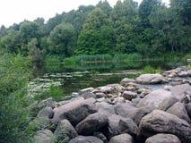 Riffle. Rivers flow through the rocks Royalty Free Stock Photo