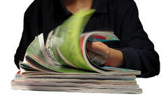 Riffling through magazines Royalty Free Stock Photo