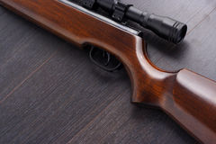 Rifle. Sniper rifle on a wooden background Stock Photo