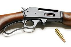Rifle. Picture of the 30-30 Marlin rifle with cartridge isolated on the white background Stock Image