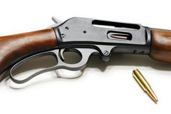 Rifle. Picture of the rifle 30-30 Marlin with cartridge isolated on the white background Stock Images