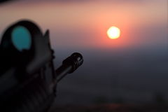 Rifle Aimed At The Sun. From the point of view of the person holding the rifle Stock Photo