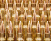 Rifle ammo. Rows of golden rifle rounds Royalty Free Stock Image