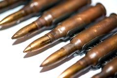 Rifle ammunition belt. Detail of the rifle ammunition belt on white background royalty free stock photography