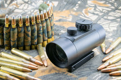Rifle ammunition and red dot sight Stock Photo