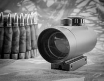 Rifle ammunition and red dot sight Stock Photography
