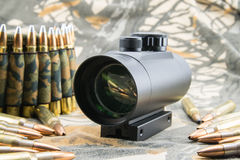 Rifle ammunition and red dot sight Royalty Free Stock Image