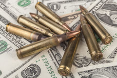 Rifle Bullets on Banknotes Royalty Free Stock Images