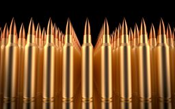 Rifle bullets lined in formation. 3d illustration Stock Photography