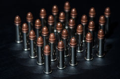 Rifle bullets over table Stock Image