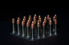 Rifle bullets over table Royalty Free Stock Photos