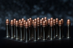 Rifle bullets over table Stock Photo
