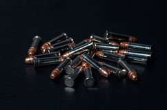 Rifle bullets over table Royalty Free Stock Image
