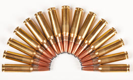 Rifle bullets packed in a half circle Royalty Free Stock Image