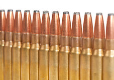 Rifle bullets packed in a straight line Royalty Free Stock Images