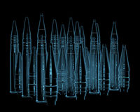 Rifle bullets. X-ray blue transparent isolated on black Royalty Free Stock Images