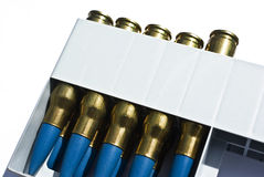 Rifle cartridges. In a pack, .308 caliber, blue color bullets Royalty Free Stock Photography