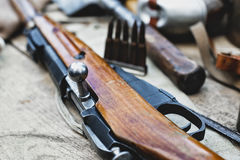 Rifle and cartridges with shallow depth of field Stock Photography