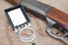Rifle And Compass. Closeup view of hunting rifle and compass Royalty Free Stock Images