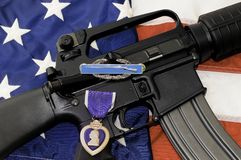 Rifle, Flag, Combat Infantryman Badge and Purple Heart Medal. Royalty Free Stock Photos