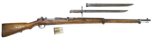 Rifle guns on a white background Russian weapons. Rifle and bayonet knife dagger guns of World War I on a white background. Russian weapons royalty free stock photo