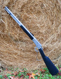 Rifle and hay Royalty Free Stock Photos