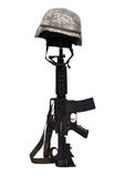Rifle with helmet. Assault rifle with helmet on white background Stock Photography