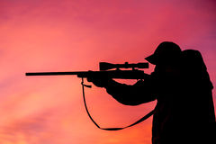 Rifle Hunter Shooting at Sunrise Stock Photography