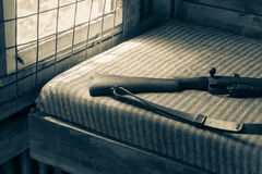 Rifle on hunters shed bed Royalty Free Stock Photos