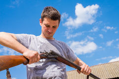 Rifle. A man holding a hunting rifle in his hand Royalty Free Stock Photos