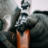 Rifle Mauser in the hands of a soldier. Shutter German rifle of World War II at the hands of the Wehrmacht soldier close-up royalty free stock photography