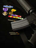 Rifle and Medals Stock Photo