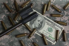 Rifle, Money And Shells Stock Photography