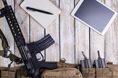 Rifle,notebook and PC tablet touch computer.Top view Stock Photo