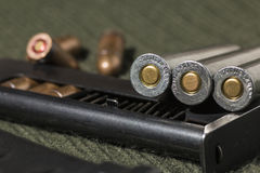 Rifle and pistol bullets Stock Photos