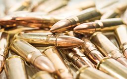 Rifle rounds. Heap of golden russian rifle rounds stock photo
