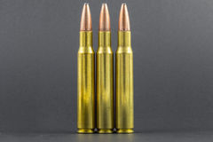 3 Rifle rounds in a row. Black background royalty free stock photo