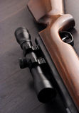 Rifle scope. Detail of a scope mounted on a sniper rifle Royalty Free Stock Images
